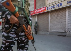 India probes late Kashmir separatist's family under terror law